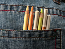 Colored pencils. Coming out from a jeans pocket royalty free stock photo