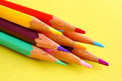 Colored pencils. On a yellow background Royalty Free Stock Photos