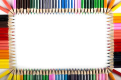 Colored Pencils Abstract Border. Colored Pencils abstract background isolated on white background Stock Photo