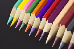 Colored pencils aligned in a row, a full color pallete Stock Image