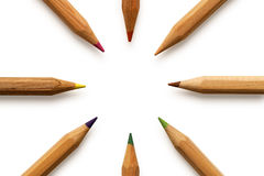 Colored pencils around. Colored pencils on white background Royalty Free Stock Photos