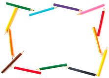 Colored pencils arranged as a frame for inscriptio Royalty Free Stock Images