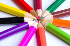 Colored pencils arranged in a circle. view from above Stock Photo