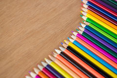 Colored pencils arranged in diagonal line Royalty Free Stock Photos