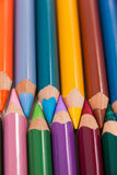 Colored pencils arranged in interlock pattern Royalty Free Stock Images