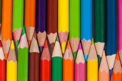 Colored pencils arranged in interlock pattern Royalty Free Stock Photography