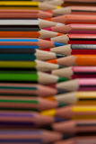 Colored pencils arranged in interlock pattern Stock Photo