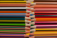 Colored pencils arranged in interlock pattern Royalty Free Stock Photos