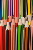 Colored pencils arranged in interlock pattern on white background Stock Image