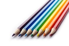 Colored pencils arranged in rainbow spectrum order Stock Image