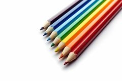 Colored pencils arranged in rainbow spectrum order Royalty Free Stock Photos