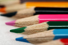 Colored pencils arranged in a row. Macro stock illustration