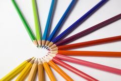 Colored pencils arranged in a semi circle. Collection of wooden colored pencils arranged in a semi-circle shape Stock Photography