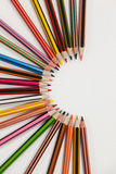 Colored pencils arranged in a semi-circle Royalty Free Stock Images