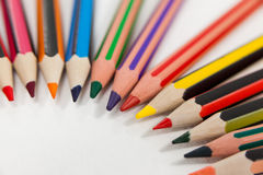 Colored pencils arranged in a semi-circle Royalty Free Stock Photos