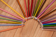 Colored pencils arranged in a semi-circle Stock Photo