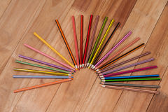 Colored pencils arranged in a semi-circle Royalty Free Stock Photography