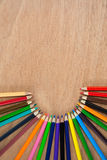 Colored pencils arranged in semi circle Royalty Free Stock Photo
