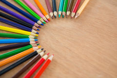 Colored pencils arranged in semi circle Royalty Free Stock Image