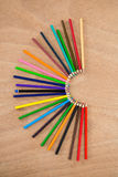 Colored pencils arranged in semi circle Stock Photography