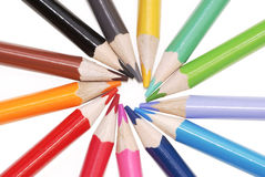 Colored pencils arranged in star shape royalty free stock photos