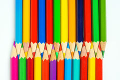 Colored pencils arrangement. Many colored crayons tips isolated on white background Stock Photography