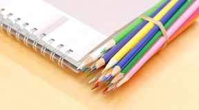 Colored Pencils with Art Book Royalty Free Stock Photo