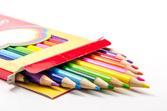 Colored Pencils. Art school colored pencils in box on white background royalty free stock photo