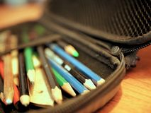 Colored Pencils and Art Supplies in Case Royalty Free Stock Photos