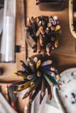 Colored pencils in the artist`s workplace Stock Images
