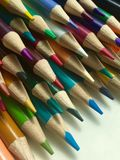 Colored pencils. Assortment of sharpened colored pencils on a white background Stock Images