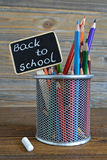 Colored pencils and back to school text written on blackboard Royalty Free Stock Photo