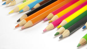 Colored pencils background. Colored pencils on a white background Stock Photo