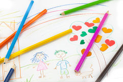 Colored pencils on the background of children's drawing Royalty Free Stock Photography