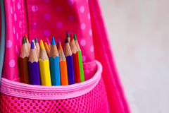 Colored pencils in backpack Royalty Free Stock Image