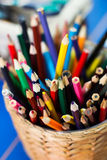 Colored pencils in basket Royalty Free Stock Image