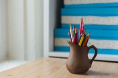 Colored pencils in a beautiful jug stock images