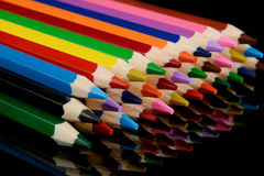 Colored pencils  on black background with reflection Stock Photos
