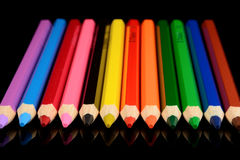 Colored pencils  on black background with reflection Stock Photo