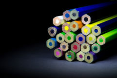 Colored pencils on a black background shadow Royalty Free Stock Photo