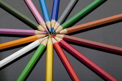 Colored pencils on black plexiglass Royalty Free Stock Photos