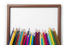 Colored pencils with a blank frame Stock Image