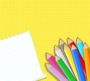 Colored pencils and blank note Royalty Free Stock Photo