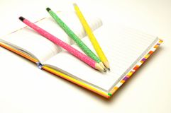 Colored pencils on bloknote Royalty Free Stock Images