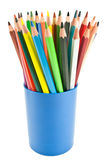 Colored pencils. In a blue cup isolated on white background Royalty Free Stock Photography