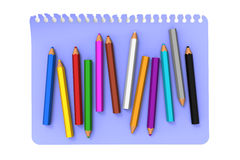 Colored pencils on blue note message paper Stock Photography