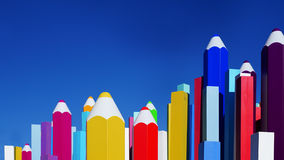 Colored pencils on blue sky background Stock Photos