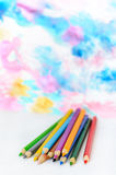 Colored pencils  on blurred colorful background Royalty Free Stock Photo