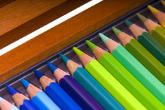 Colored pencils in a box Stock Photos
