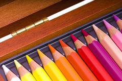 Colored pencils in a box Royalty Free Stock Photos